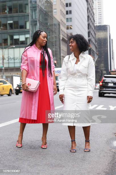 Shiona Turini is seen wearing a pink Kate Spade coat a red Balenciaga dress pink Kate Spade bag and red Prada shoes Nicole Chapoteau wearing a white...