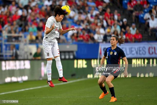 Shiori Miyake of Japan heads the ball against Kelley O'Hara of the United States during the first half of the SheBelieves Cup match at Toyota Stadium...