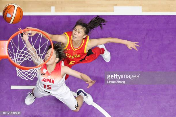 Shiori Yasuma of Japan drives to the basket against Wang Siyu of China during the Basketball Women's 5x5 match between Japan and China at the GBK...