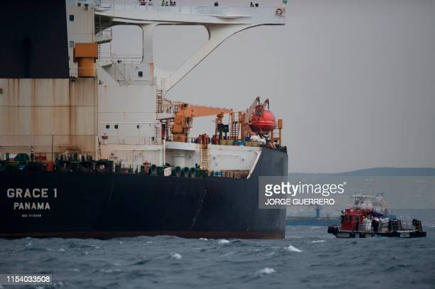Ship approaches supertanker Grace 1 off the coast of Gibraltar on July 6, 2019. - Iran demanded on July 5, 2019 that Britain immediately release an...