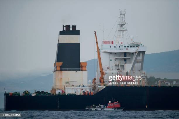 A ship approaches supertanker Grace 1 off the coast of Gibraltar on July 6 2019 Iran demanded on July 5 2019 that Britain immediately release an oil...