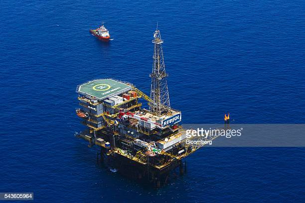 A ship approaches the Casablanca oil platform operated by Repsol SA in the Mediterranean Sea off the coast of Tarragona Spain on Tuesday June 28 2016...