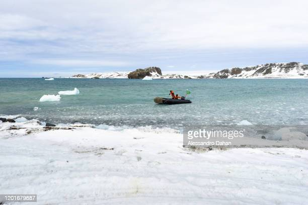 Ship boarding operation with divers in zodiacs under ice on November 04 2019 in King George Island Antarctica