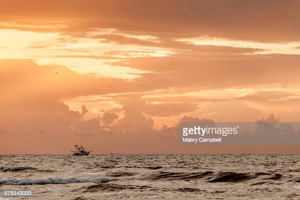 Ship boat in the gulf of Mexico at sunrise