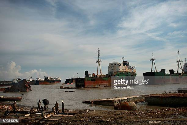 Ship breakers work on the dismantling of a ship for scrap July 24 2008 in the port city of Chittagong Bangladesh The tightly policed ship yards...