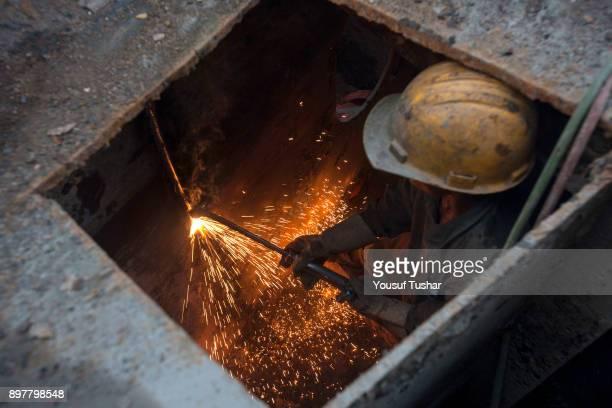 SITAKUNDO CHITTAGONG BANGLADESH Ship breaking laborer cutting ship at Sitakundo ship breaking yard The ship breaking industry at Sitakundo started...