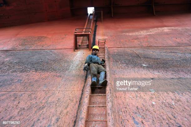 Ship breaking laborer working at Sitakundo ship breaking yard. The ship breaking industry at Sitakundo started its operation in 1960.Due to lower...