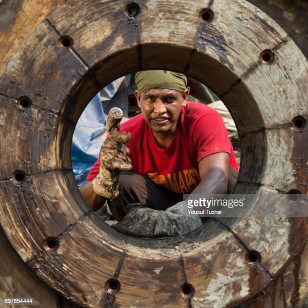 SITAKUNDO CHITTAGONG BANGLADESH Ship breaking labors cutting parts of ship at Sitakundo ship breaking yard The ship breaking industry at Sitakundo...