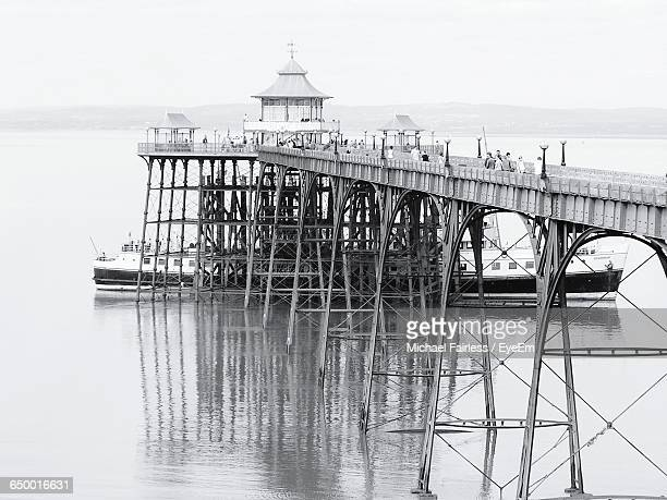 ship by clevedon pier in sea against sky - clevedon pier stock pictures, royalty-free photos & images