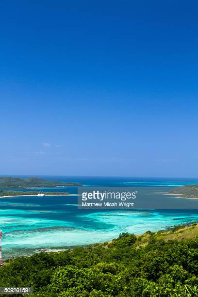 a ship docks at the blue lagoon. - western division fiji stock photos and pictures