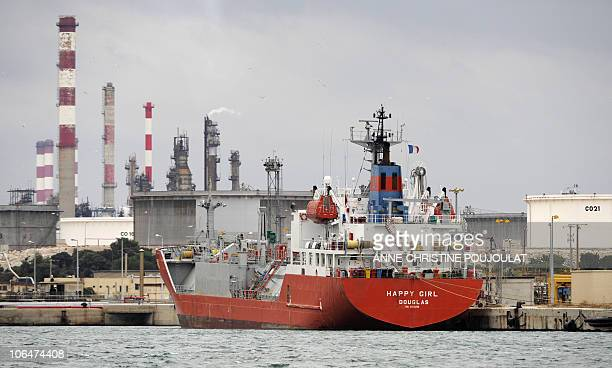 A ship has docked on October 30 2010 at Lavera oil harbour in Martigues southern France following the end of its blockade by strikers Workers at oil...