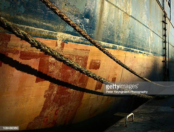 Ship hull with ropes and ladder in morning light