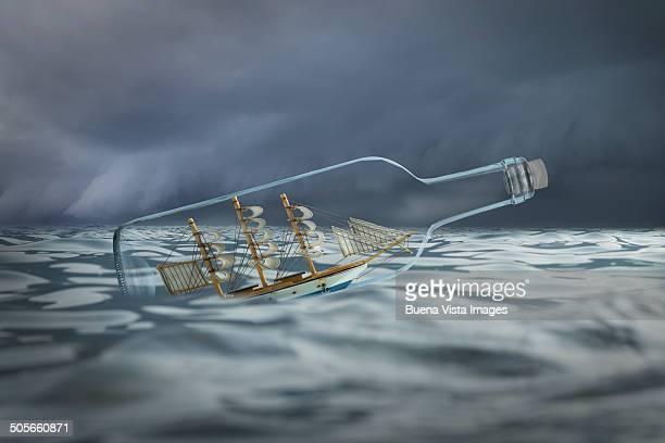 Ship in a bottle in rough waters