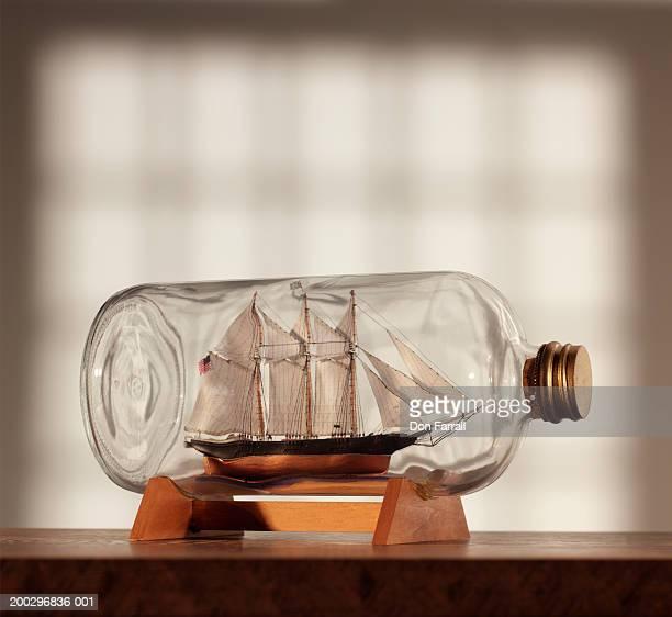 Ship in bottle near window, side view