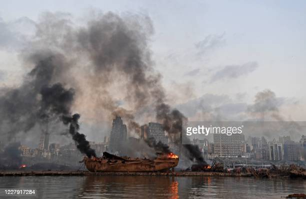 Ship in flames is pictured at the port of Beirut following a massive explosion that hit the heart of the Lebanese capital on August 4, 2020. -...