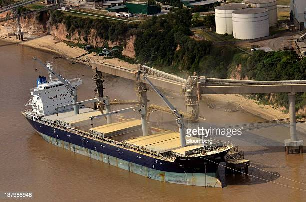 A ship is loaded at the Port of Rosario on the Parana River in Rosario Argentina on Friday Jan 20 2012 Argentina's trade surplus was $280 million in...