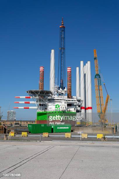A ship is loaded with wind turbine components for offshore installation on July 23 2018 in Ostend Belgium