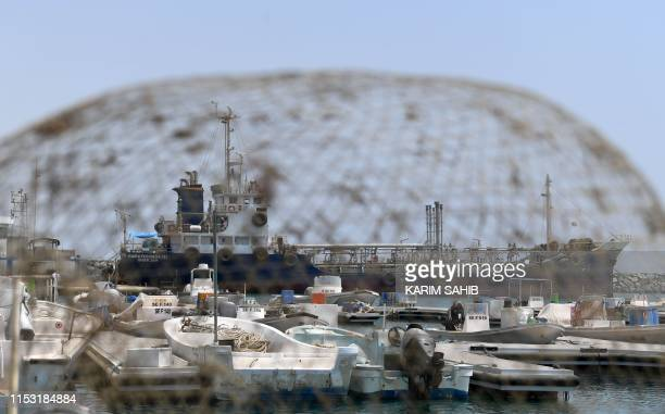 A ship is picture through a fishing net in the port of Fujairah on July 2 2019 in the east of the United Arab Emirates where recent tensions...