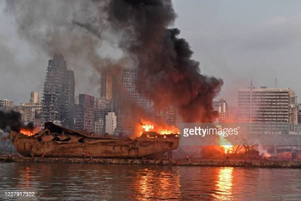 Ship is pictured engulfed in flames at the port of Beirut following a massive explosion that hit the heart of the Lebanese capital on August 4, 2020....