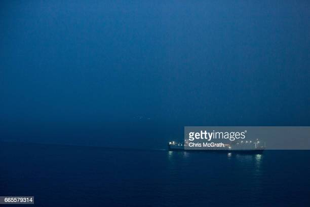 Ship is seen coming into port amid heavy fog on April 4, 2017 in Zonguldak, Turkey. More than 300 kilometers of coal mineÕs riddle the mountains of...