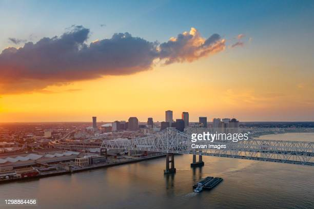 a ship is under the new orleans bridge in the evening from above - new orleans stock pictures, royalty-free photos & images