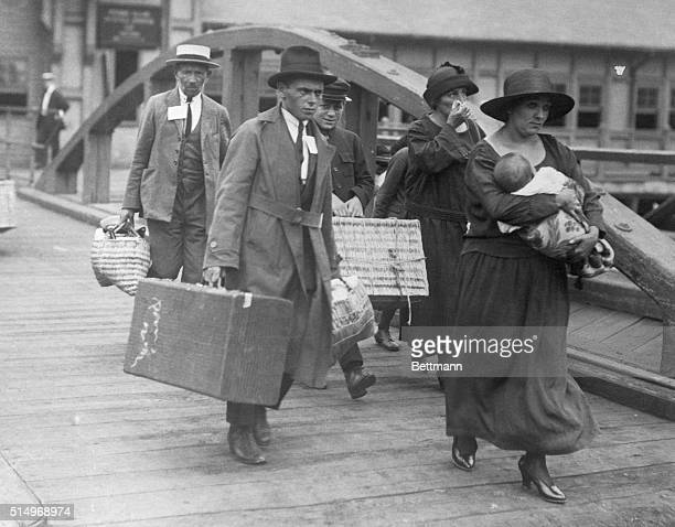 Ship loaded with immigrants coming to New York A Greek family embarking on Ellis Island to come to America