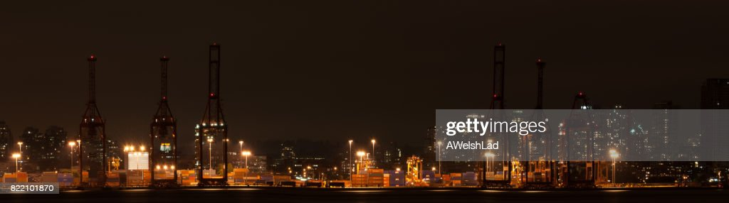 Ship loading docks Vancouver, BC in the evening panorama : Stock Photo