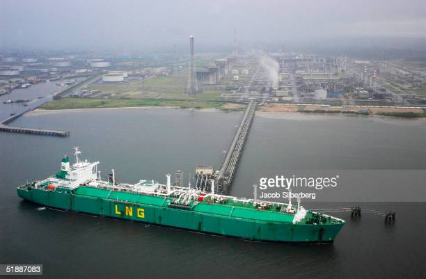 A ship loads liquefied natural gas from the Nigerian Liquefied Natural Gas plant October 12 2004 on Bonny Island Nigeria A member of OPEC Nigeria is...