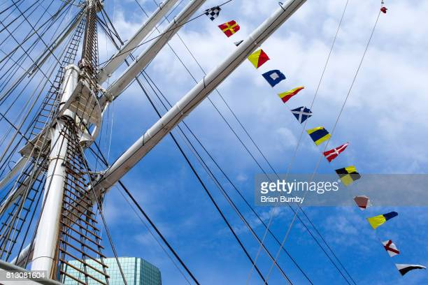 ship masts with nautical flags - south street seaport stock photos and pictures