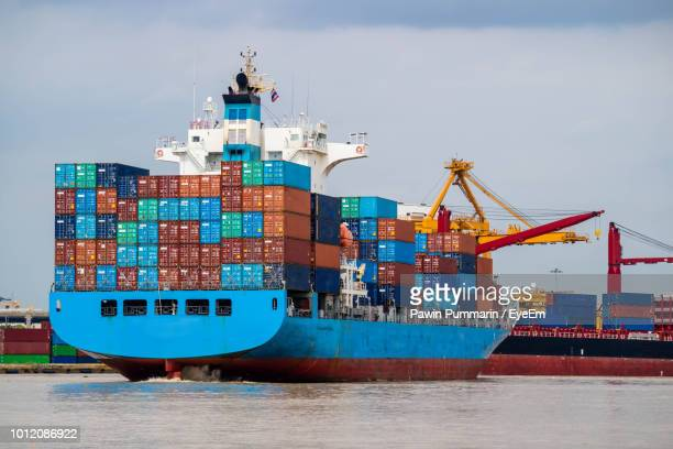 ship moored at harbor against sky - container ship stock pictures, royalty-free photos & images