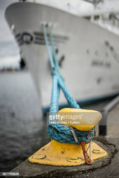 ship moored by bollard at harbor - bollard stock photos and pictures