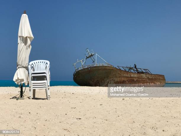 Ship Moored On Beach Against Clear Sky