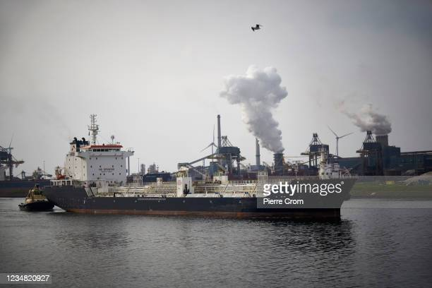 Ship navigates on the North Sea canal outside the Tata Steel plant on August 21, 2021 in Ijmuiden. The Tata steel plant is under investigation by the...