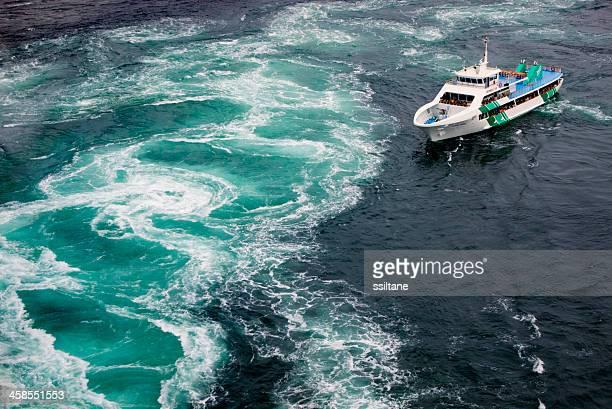 ship near vortex naruto japan - naruto stock photos and pictures