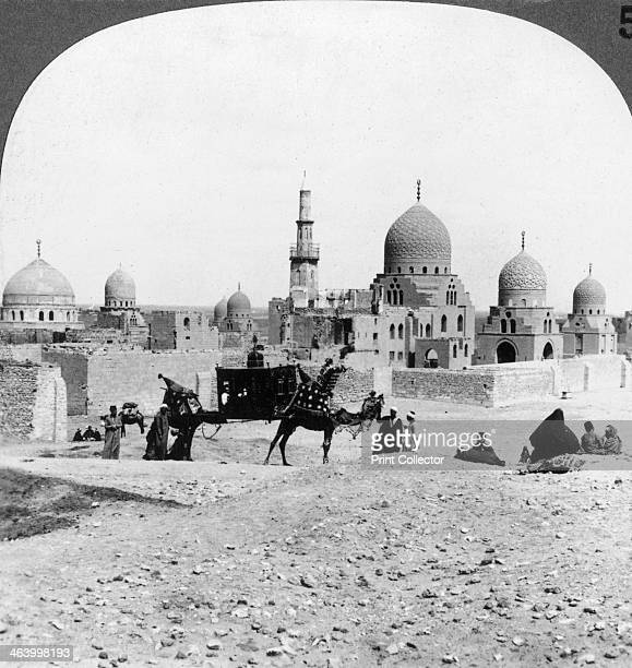 'A 'Ship of the Desert' passing tombs of bygone Moslem rulers Cairo Egypt' 1905 'We look along the northern end of a line of royal tombs which...