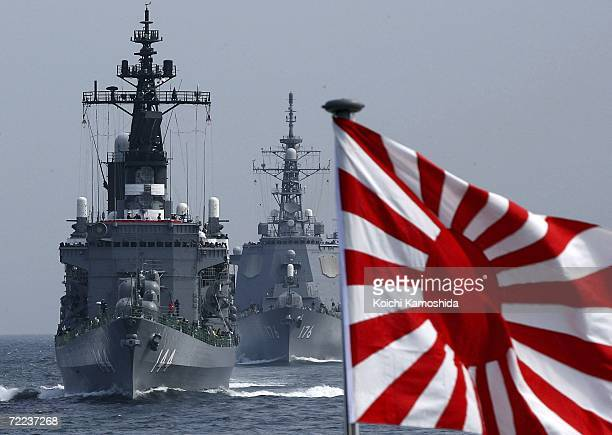 Ship of the Japanese Maritime Self-Defense Force sails in formation during a naval fleet review exercises on October 22, 2006 off Sagami Bay, Japan....