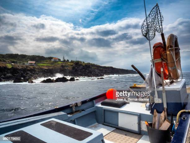 ship of traditional fishing out of the water in a fishing port maritime in terceira island in the azores islands, portugal. - barco pesquero fotografías e imágenes de stock