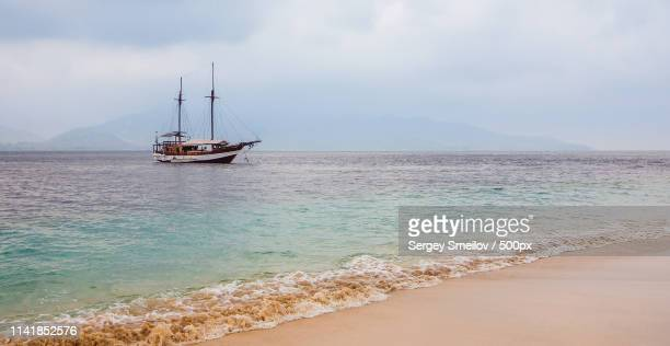 a ship off the coast of bali - off stock pictures, royalty-free photos & images