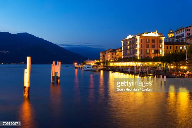Ship On Lake Como By Buildings Against Clear Sky At Dusk