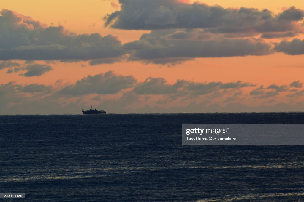 A ship on Sagami Bay in the orange sunset in Japan : Stock-Foto