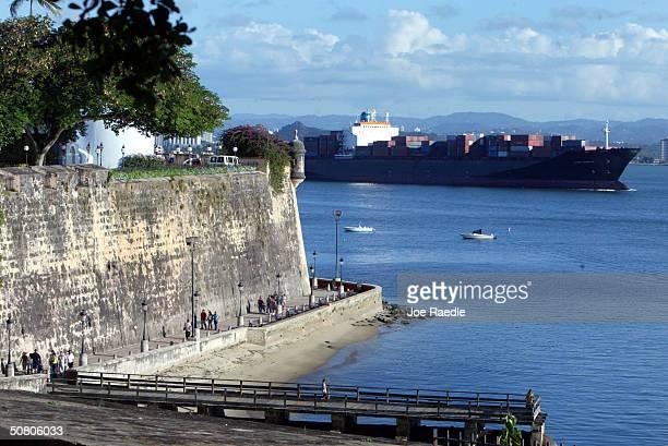A ship passes past part of the wall that makes up La Fortaleza April 26 2004 in Old San Juan the original capital city of San Juan Puerto Rico...