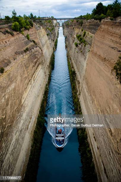 a ship passing by the corinth canal - narrow stock pictures, royalty-free photos & images