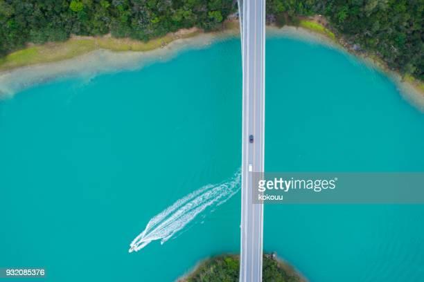 A ship passing under the bridge.