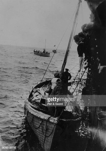 Ship rescuing survivors from a sunken merchant ship in the Atlantic Ocean, France.
