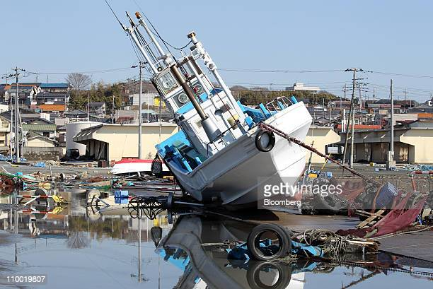 Ship runs aground at Oarai Port after the earthquake, in Oarai town, Ibaraki prefecture, Japan, on Saturday, March 12, 2011. Japan awoke to images of...