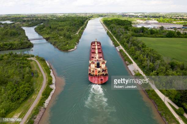ship sailing away aerial image - lake superior stock pictures, royalty-free photos & images