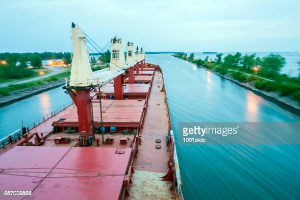ship sailing detroit canal in usa - passing canal - great lakes stock pictures, royalty-free photos & images