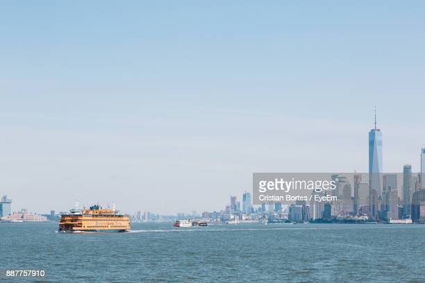 Ship Sailing In Sea Against Clear Sky