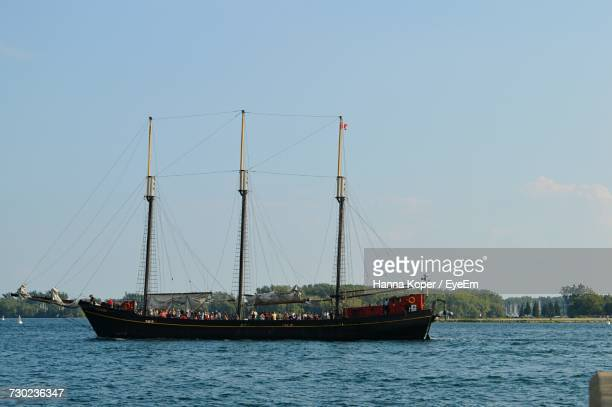 ship sailing on river against clear sky - koper stock photos and pictures