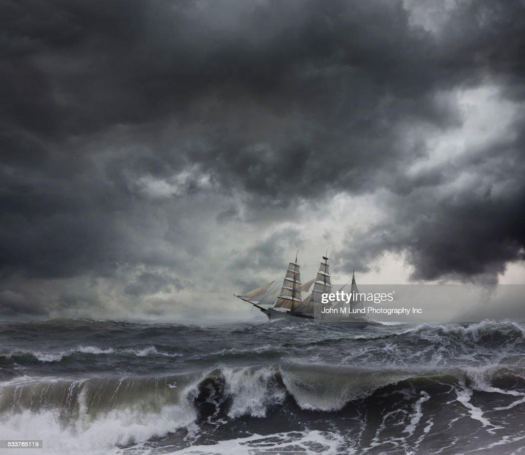 Ship sailing on stormy seas : Stock Photo